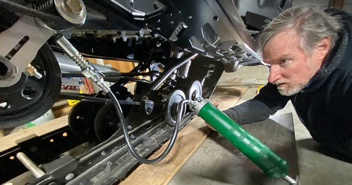 Greasing upgraded Snowmobile Suspension With Grease Fittings Zerks